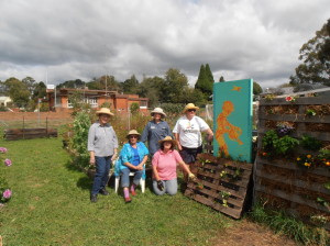 The Garden Team showing off our new pallet gardens.