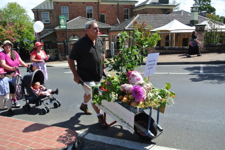 Ed wheeling our float full of organic veges & fruit on the Bush Week Parade in Moss Vale - March 2014