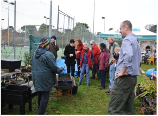 Rosina demonstrating worm farms at a previous open day