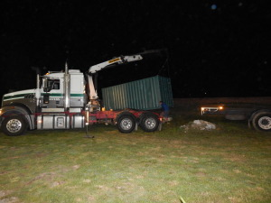 The container is lifted into place